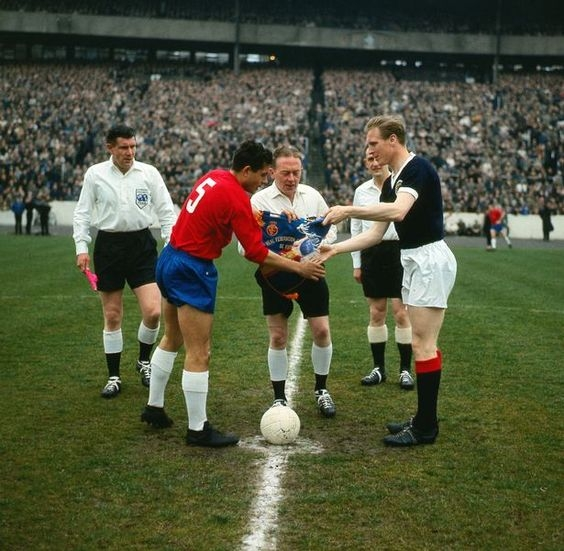 Pennants exchange before the friendly match Scotland vs Spain played in the 60s